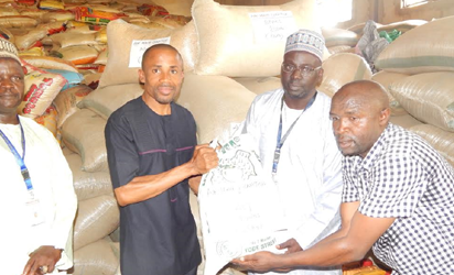 Corporate Communications Manager of Air Peace, Chris Iwarah (left) presenting relief materials donated by the airline to internally-displaced persons (IDPs) in Yobe State to the Executive Secretary, Yobe State Emergency Management Agency (SEMA), Musa Idi Jidawa