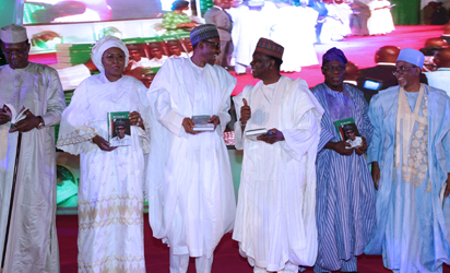 President Muhammadu Buhari (M) chats with former Head of State, Dr Yakubu Gowon. With are President of Niger Mr Mahamadou Issoufou, President of Tchad, Idriss Deby, Wife of the President, Mrs. Aisha Buhari,  Former President Chief Olusegun Obasanjo and one other during a book launch on President Muhammadu Buhari tittle: The Challenges of Leadership in Nigeria by Mr John N Paden held at the International Conference Centre in Abuja