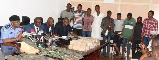 Photos: @NPF parade kidnappers of CBN Governor's wife, display huge money, items recovered