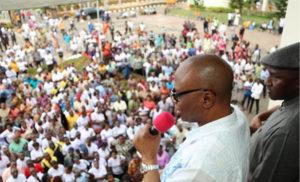 Mimiko addressing NULGE members during a Thank You rally in Akure