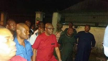In red Rivers Police Commissioner, Mr Francis Odesanya, governor Nyesom Wike in dark native beside the CP  Judge's residence.