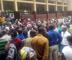 Parents and students gather at Government Model, College, Igbonla, Epe, Lagos yesterday.