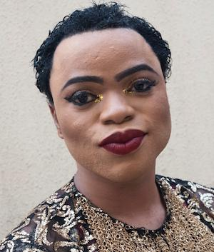 Snapchat celebrity and Nigerian male Barbie, Bobrisky, poses on November 7, 2016 in Lagos. Bobrisky sells skin lightening creams and in 2016 catapulted to fame as a social media celebrity chronicling his makeup looks. / AFP PHOTO / STEFAN HEUNIS