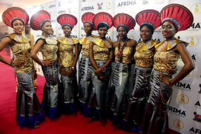 Hostesses pose for photograph during the All Africa Music Awards (AFRIMA) ceremony in Lagos, on Monday, November 6, 2016. 82-year-old Cameroonian vibraphone and saxophonist Manu Dibango, was recognised for making tremendous contributions to African music, especially for developing a music style fusing jazz, funk and traditional Cameroonian music. The All Africa Music Awards is designed to recognise and reward artiste who have given African music the most creative competitive edge in the global market within the year under review. AFP