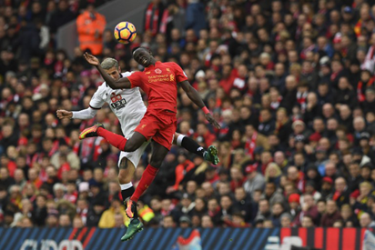 Watford's Yugoslavian-born Swiss midfielder Valon Behrami (L) vies in the air with Liverpool's Senegalese midfielder Sadio Mane during the English Premier League football match between Liverpool and Watford at Anfield in Liverpool, north west England on November 6, 2016. AFP