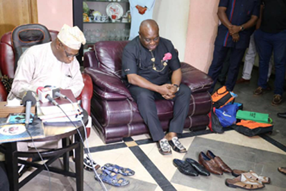 Obasanjo (left) with Ikpeazu admiring the Made-in-Aba shoes delivery