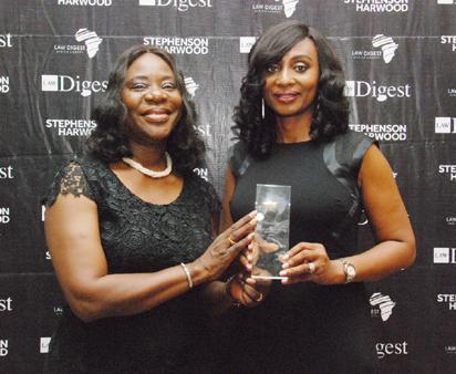 L-R; Mrs. Funke Adekoya SAN presenting female managing partner award of the year to the managing partner, Olisa Agbakoba Legal, Mrs. Priscilla Ogwemo, at the  law Digest award in Lagos.