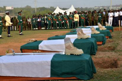Remains Lt. Col. Mohammed Abu-ALI, five solders and a seaman, during their burial in Abuja on Monday (7/11/16).