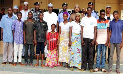 The rescued persons with security officers.