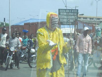 Masquerade, followers cart away chickens, foodstuff from Lagos markets