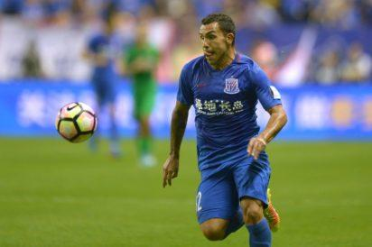 Tevez scores but Shenhua thrashed in Shanghai derby