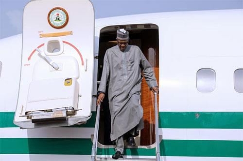 Photos: Buhari returns to Abuja from Turkey