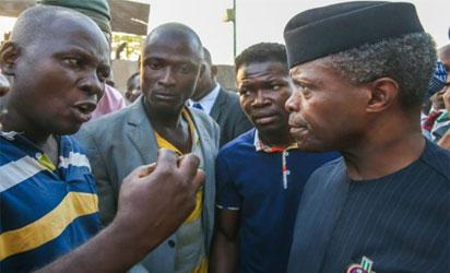Osinbajo, ever attentive, listens to one of the leaders