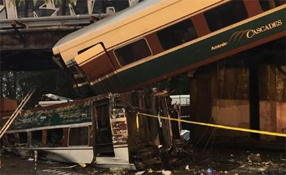 Update: Derailed US train was going 80 mph in 30 mph zone