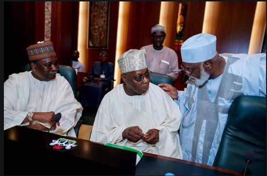 Former heads of state, Obasanjo, Gowon, Abubakar exchanging pleasantries ahead of the National Council of State Meeting at the State House,