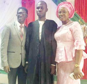 From left— Visually-impaired graduate of law, Barrister Adesola Ajayi (middle) flanked by Pastor Jummy Adetoyese-Olagunju, Senior Pastor, Praise Arena-Kingdom Light Christian Centre, and his wife, Fummilayo, during the celebration thanksgiving for Ajayi, one of the beneficiaries of the church scholarship programme.