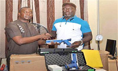 •Dr Jonathan Nnaji, President Nigeria Modern Pentathlon Federation (l) receiving equipment from Hillary Obinech Akandu, CEO Nechi Investment Ltd