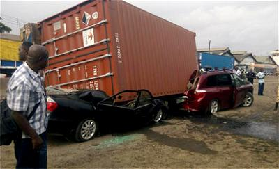 A truck fell on stationary Sienna and Camry cars yesterday at Tin-can Island to Apapa, Lagos yesterday.