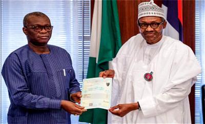 Buhari receiving WAEC certificate from the Registrar of the West African Examinations Council (WAEC)
