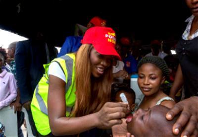 Polio, Tiwa Savage immunising a child against polio.