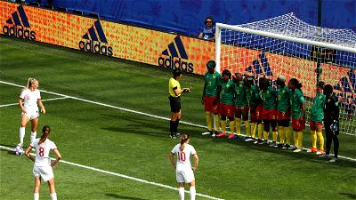 Cameroon players line up in a wall