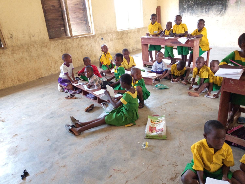 Pupils of Primary School, Nsukara Offot Uyo, sitting on the floor