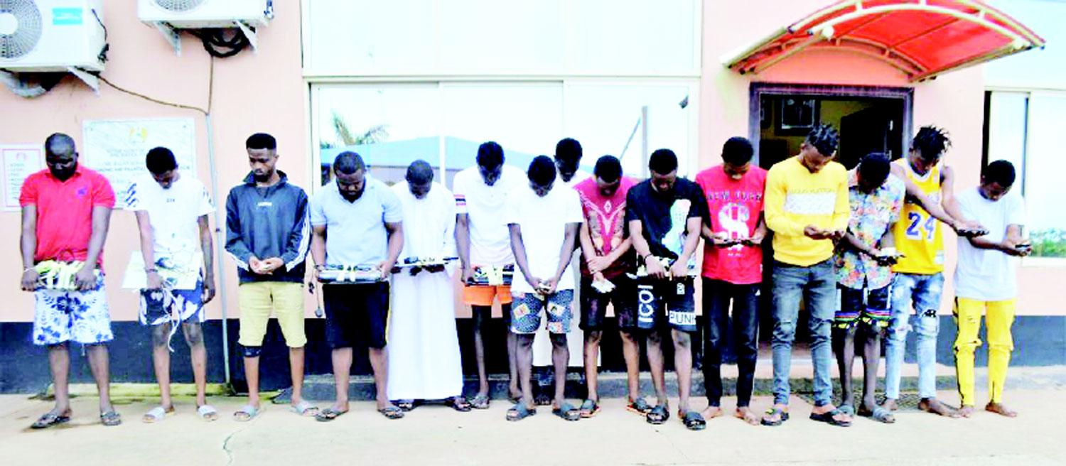 The 15 suspected internet fraudsters paraded with their working tools in Ibadan, yesterday.
