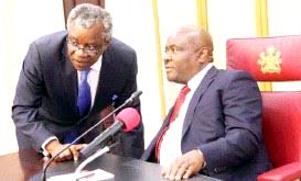 RIRS boss, Adoage Norteh (left) rubbing minds with Governor Nyesom Wike