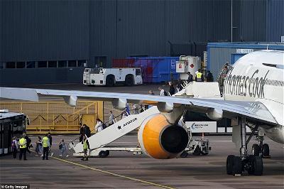 Thomas Cook passengers applaud staff after final flight lands in UK
