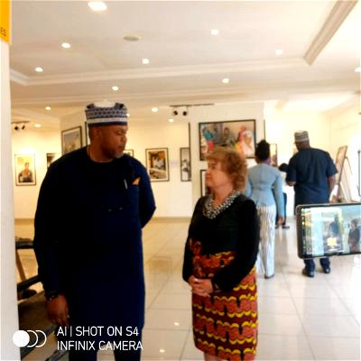 L-R: Country Director, Center for Civillians In Conflict, CIVIC, Tunde Ojei and the British High Commissioner to Nigeria, Catriona Lang, at the Photo Exhibition held in Abuja.