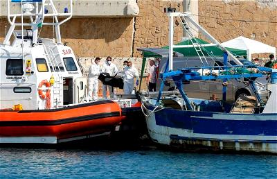 At least three migrants die as boat catches fire