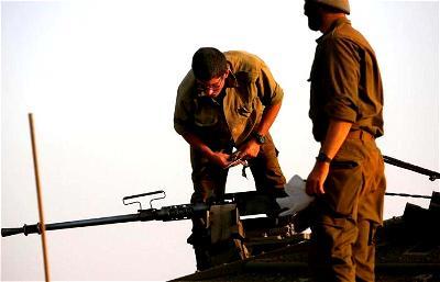 Israeli army says it hit squad placing explosives along Syria border