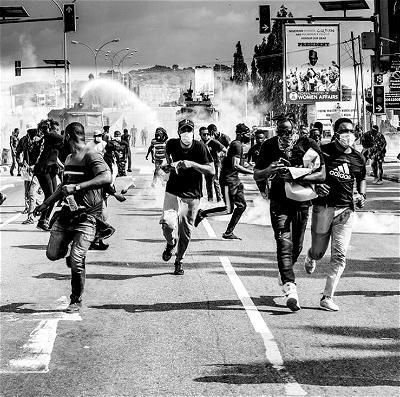 Police teargas #EndSARS protesters in Abuja