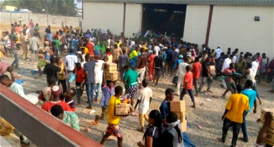 VIDEOS: Ongoing looting of warehouse in Abuja
