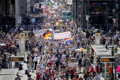 Thousands protest restrictions as Germany posts record virus numbers
