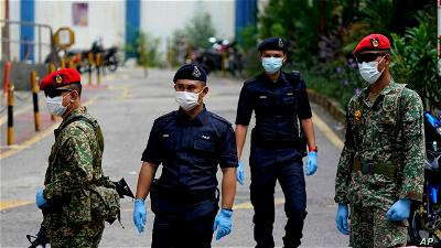 Get COVID-19 jab or leave the force, Malaysian I-G warns officers